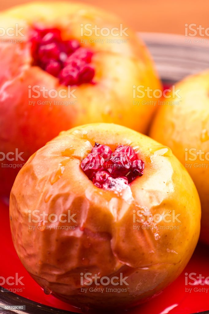 baked apples cranberry stock photo
