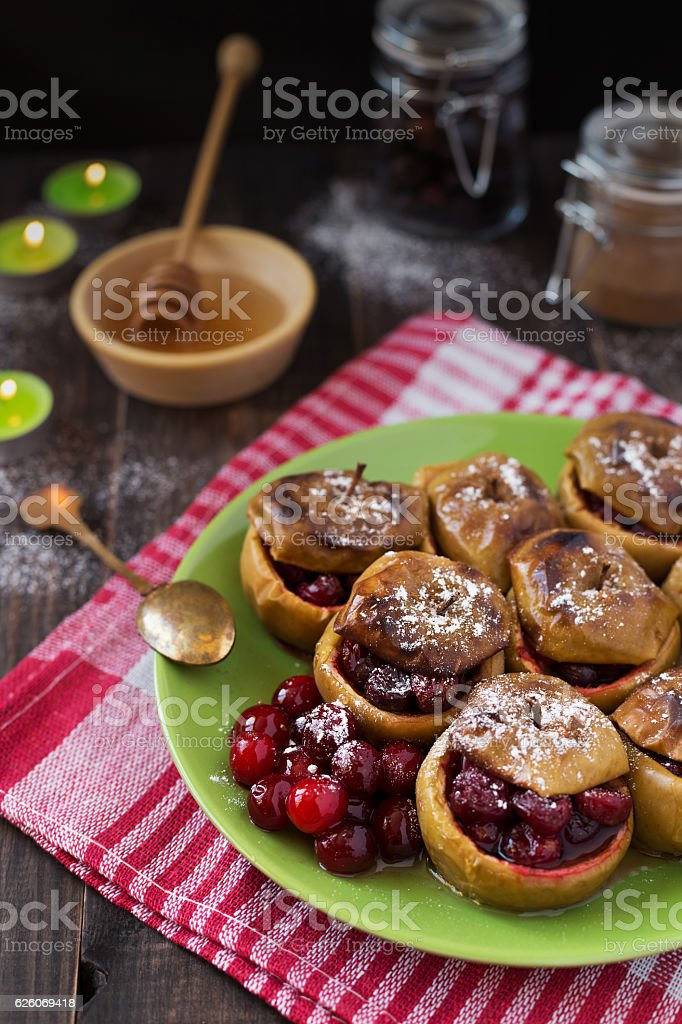 Baked apples with cranberries stock photo