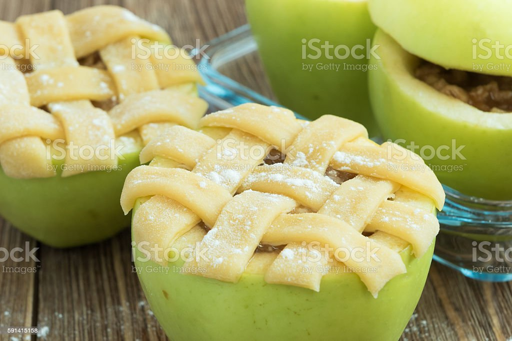 Baked apples with oats, raisins, almonds and honey stock photo
