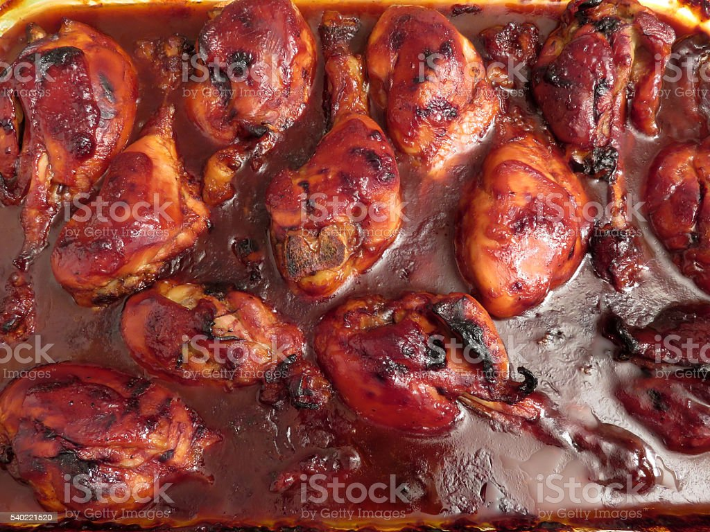 Baked Barbecue Chicken Drumsticks stock photo