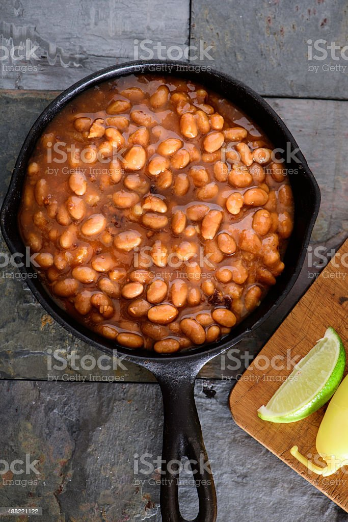 Baked Beans in cast iron pan stock photo