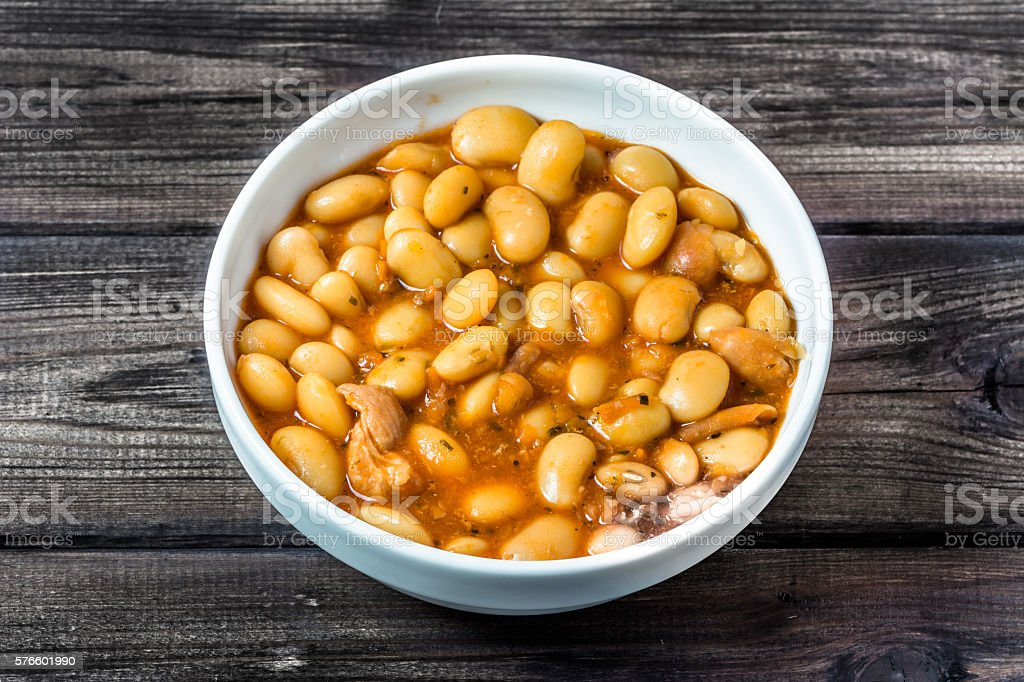 Baked beans in tomato sauce stock photo