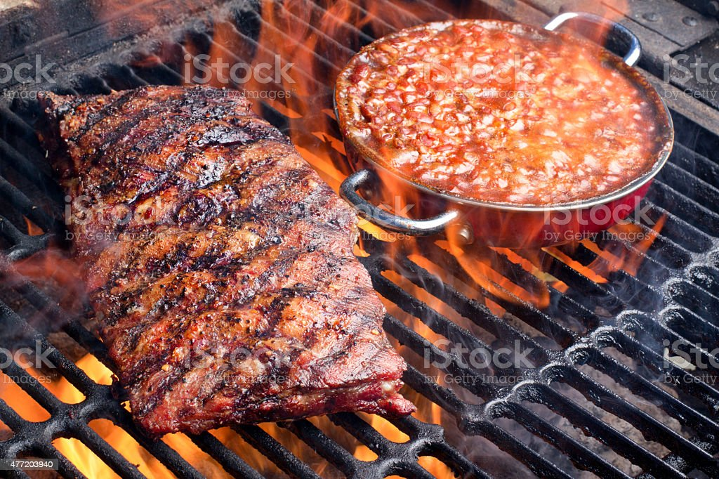Baked Beans on a Grill with Baby Back Ribs stock photo