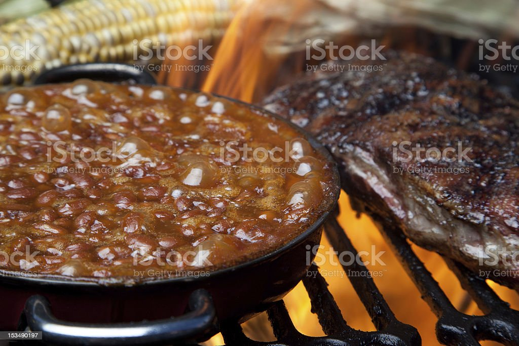 Baked Beans on Flaming Grill royalty-free stock photo