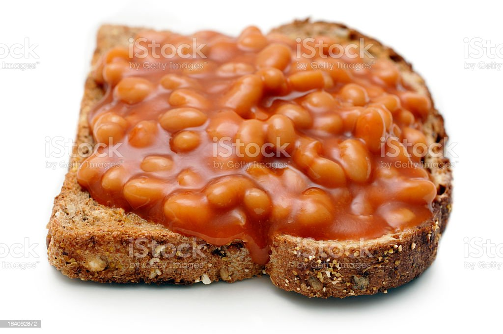 Baked Beans on wholemeal toast against white background royalty-free stock photo