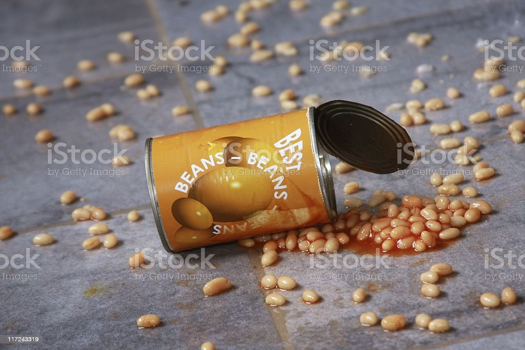 Baked beans spill on floor stock photo