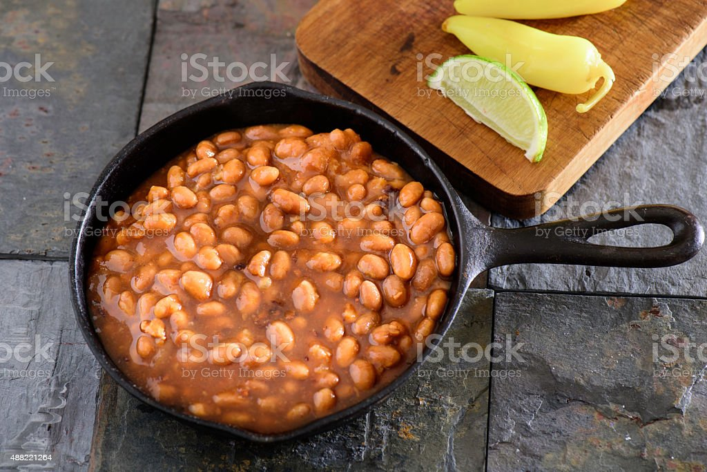 Baked Beans with pickled pepper stock photo