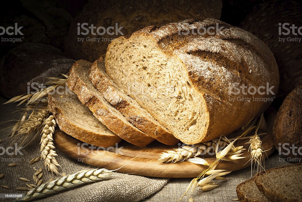 baked bread on wooden table stock photo