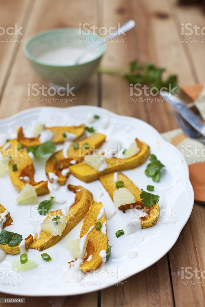 Baked butternut squash salad with cilantro, lime and green onion royalty-free stock photo