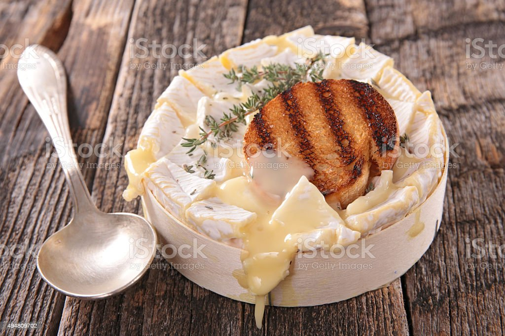 baked camembert and bread stock photo