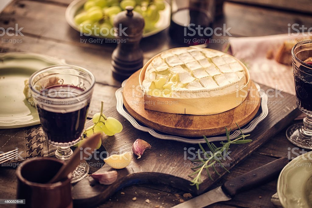 Baked Camembert Cheese with Garlic and Rosemary stock photo