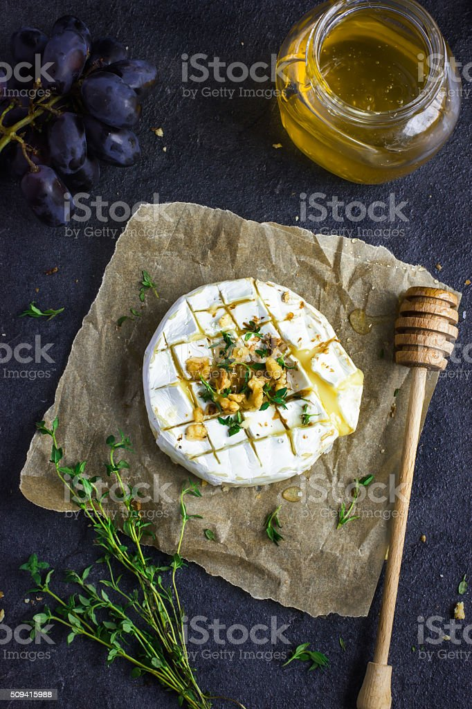 baked camembert cheese with  nuts and honey stock photo