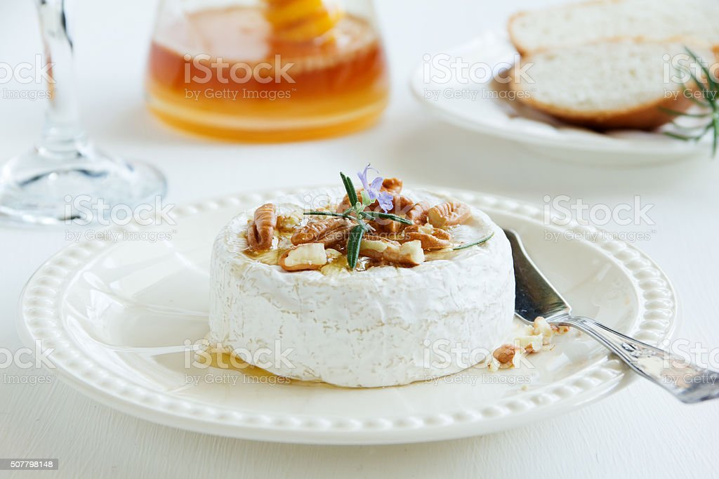 Baked camembert with honey and pecans. stock photo