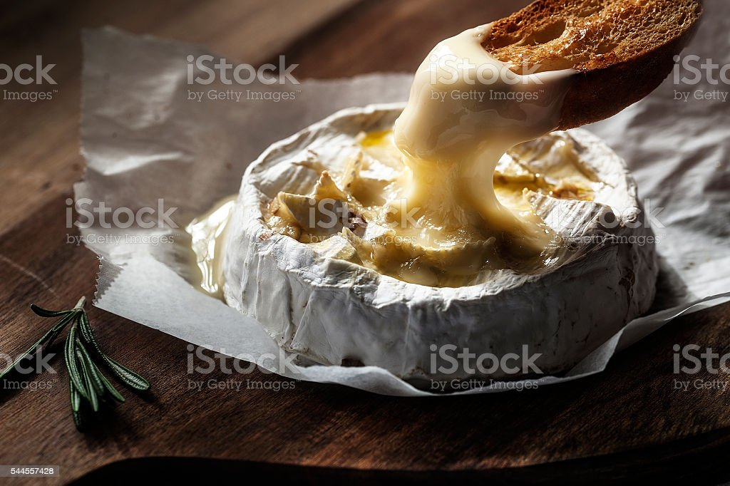 Baked camembert with toast and rosemary stock photo