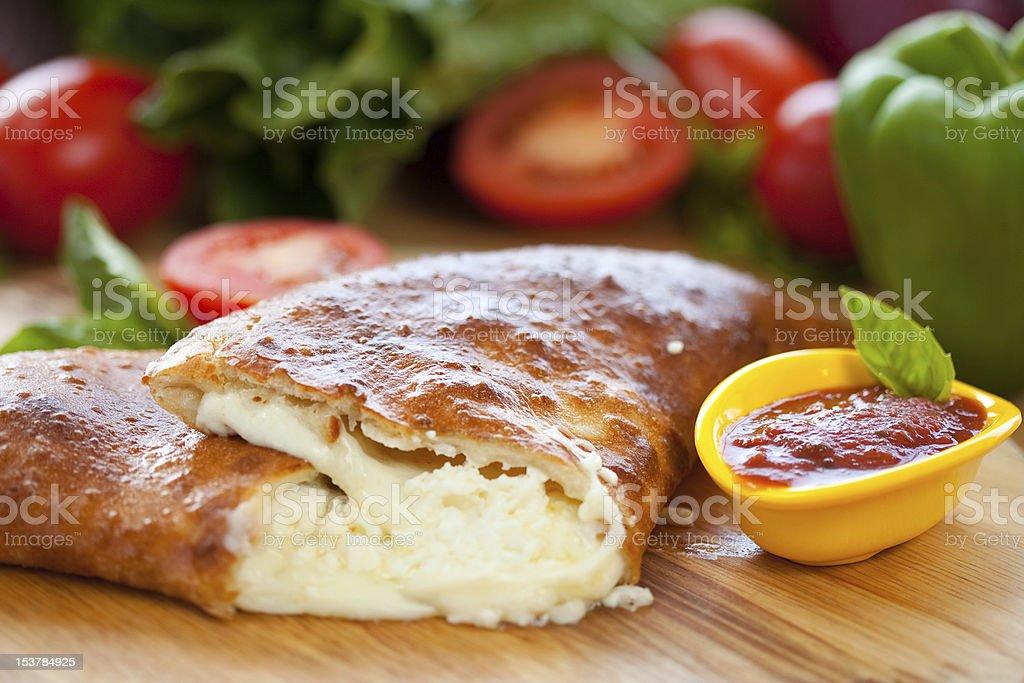 Baked Cheese Calzone with marinara royalty-free stock photo