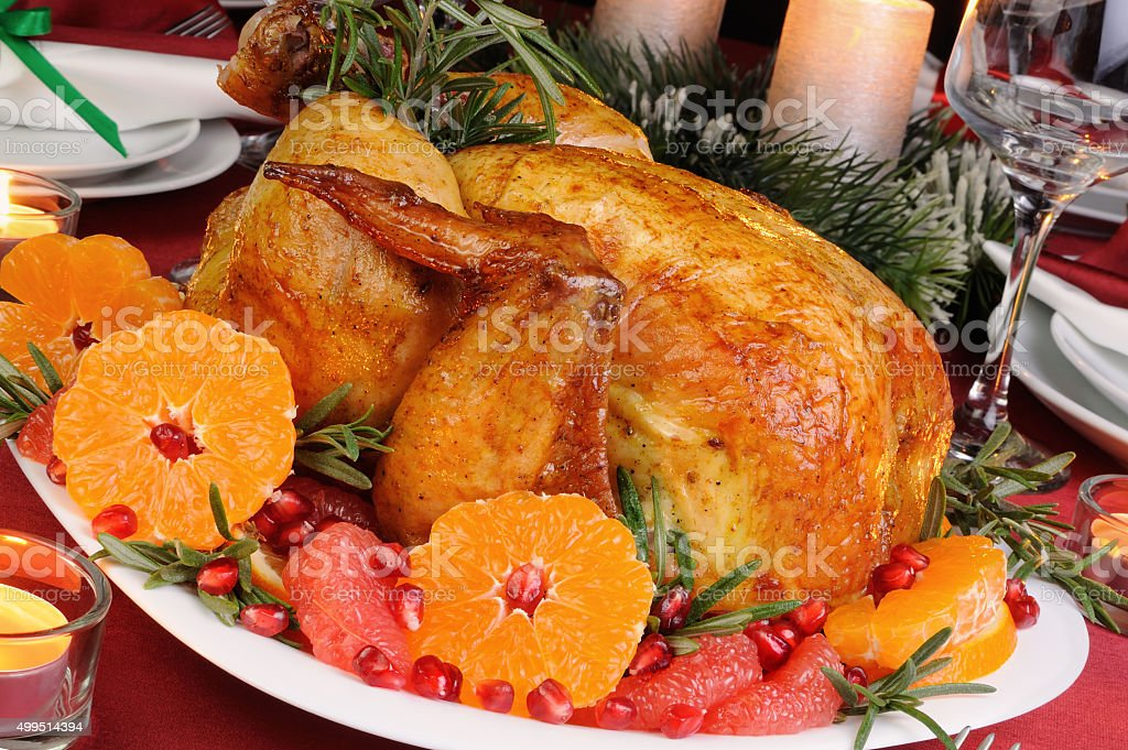 Baked chicken at the Christmas table stock photo