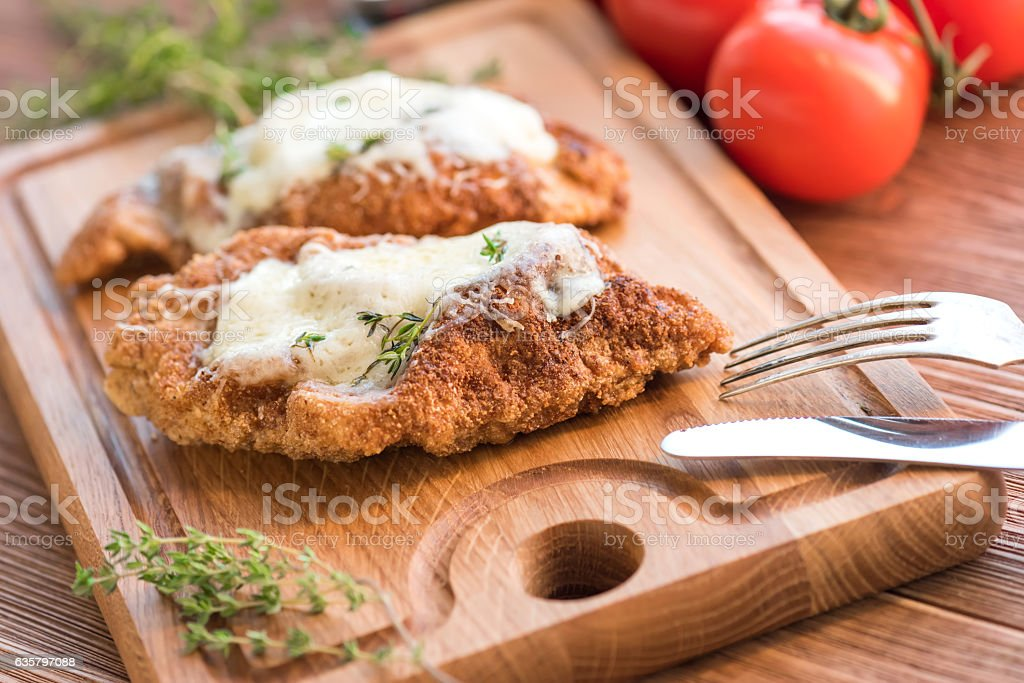 Baked chicken breast with parmesan. stock photo