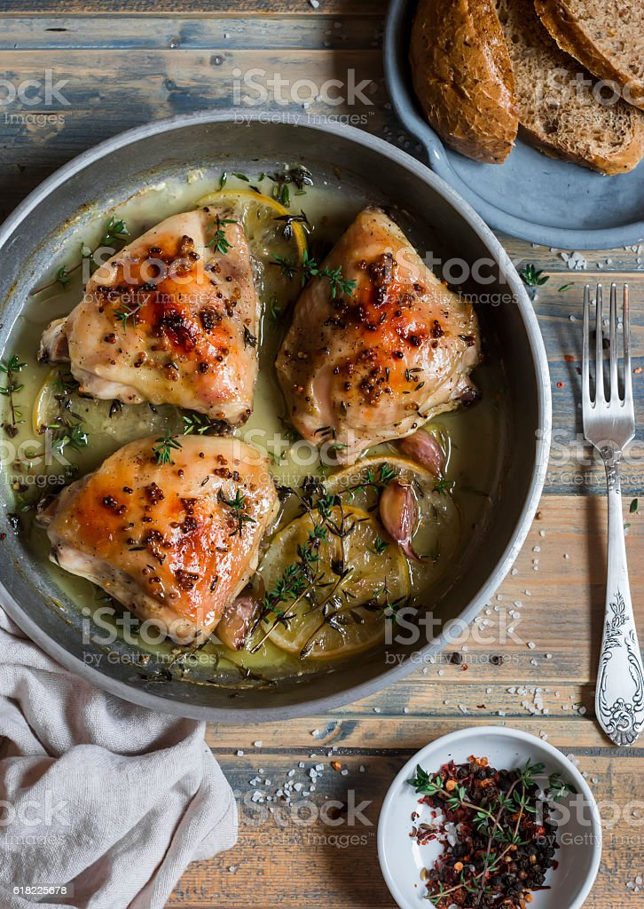 Baked chicken in white wine in the pan. stock photo