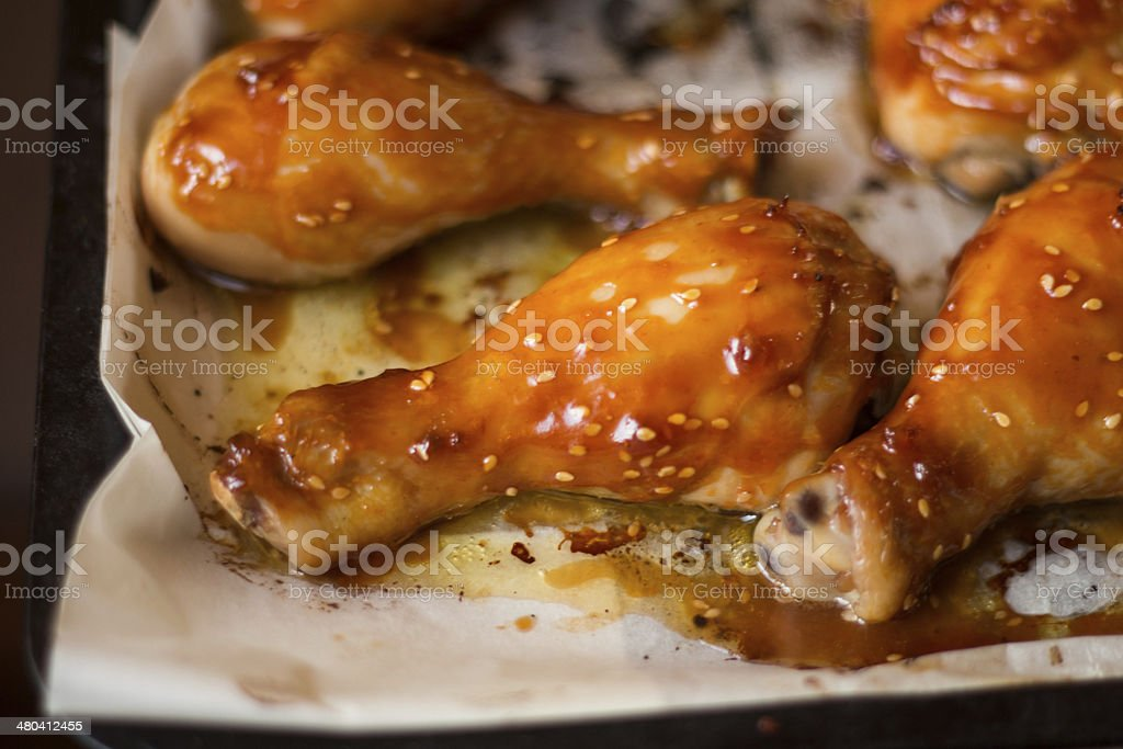 baked chicken legs with spicy sauce stock photo