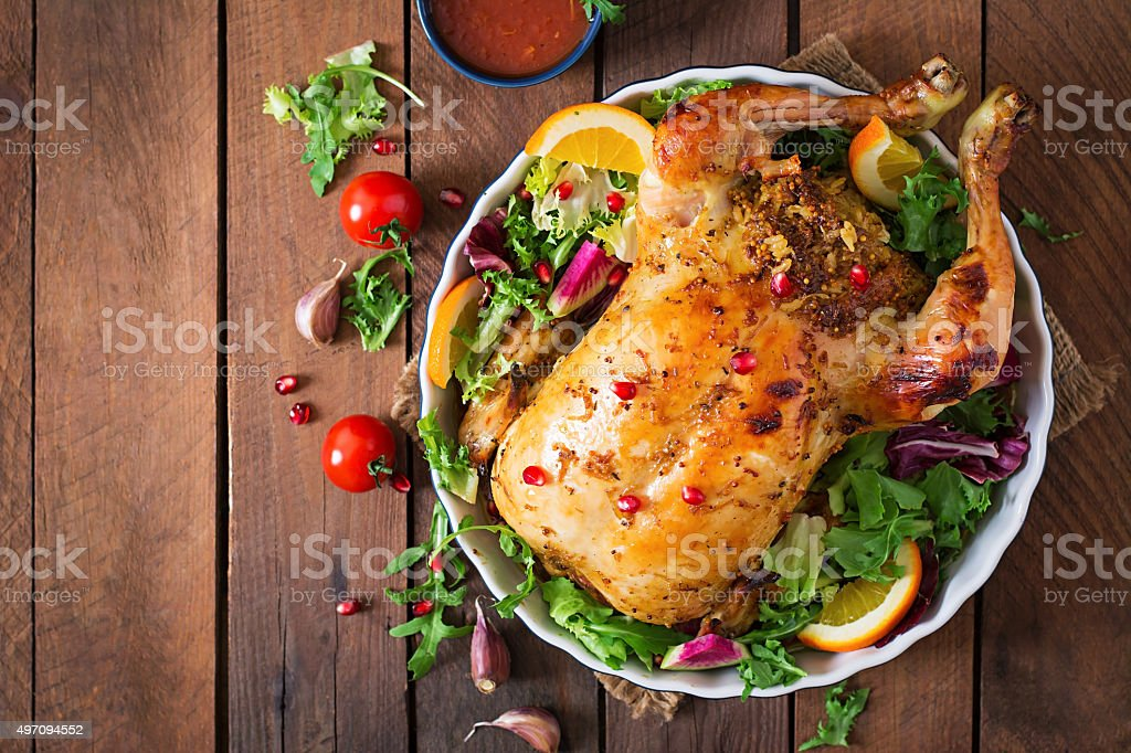 Baked chicken stuffed with rice for Christmas dinner stock photo