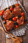 Baked chicken thigh with mustard, tomatoes and wild mushrooms