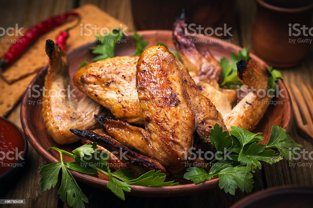 Baked chicken wings in the oven, close-up stock photo