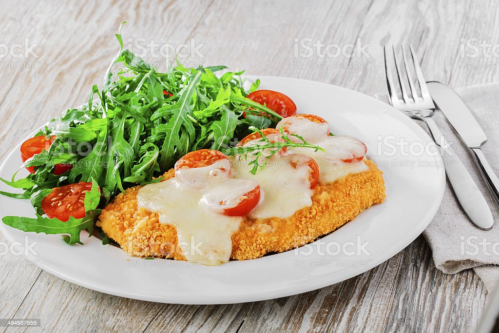 Baked chicken with mozzarella and cherry tomatoes  fillet stock photo