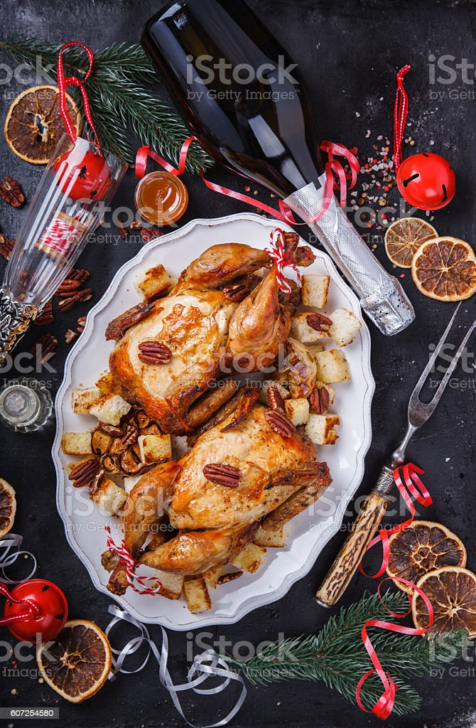 Baked chicken with oranges.Dinner for Christmas stock photo
