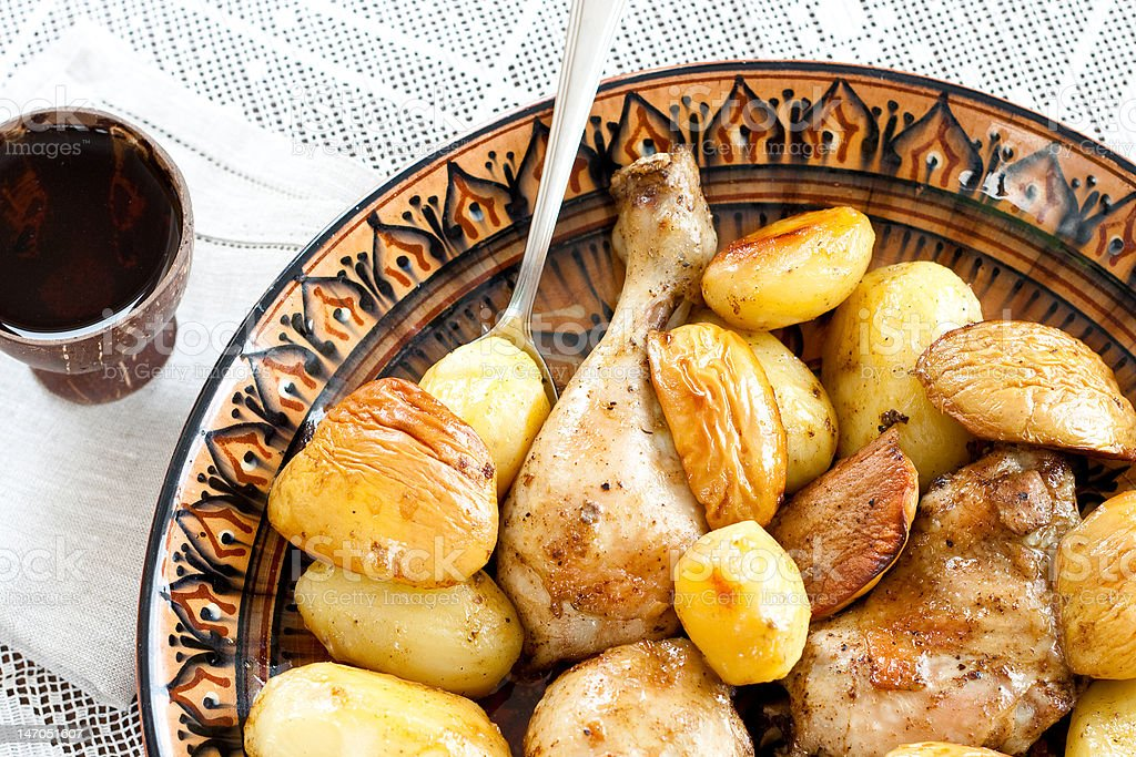 Baked chicken with potato and apple-quince royalty-free stock photo