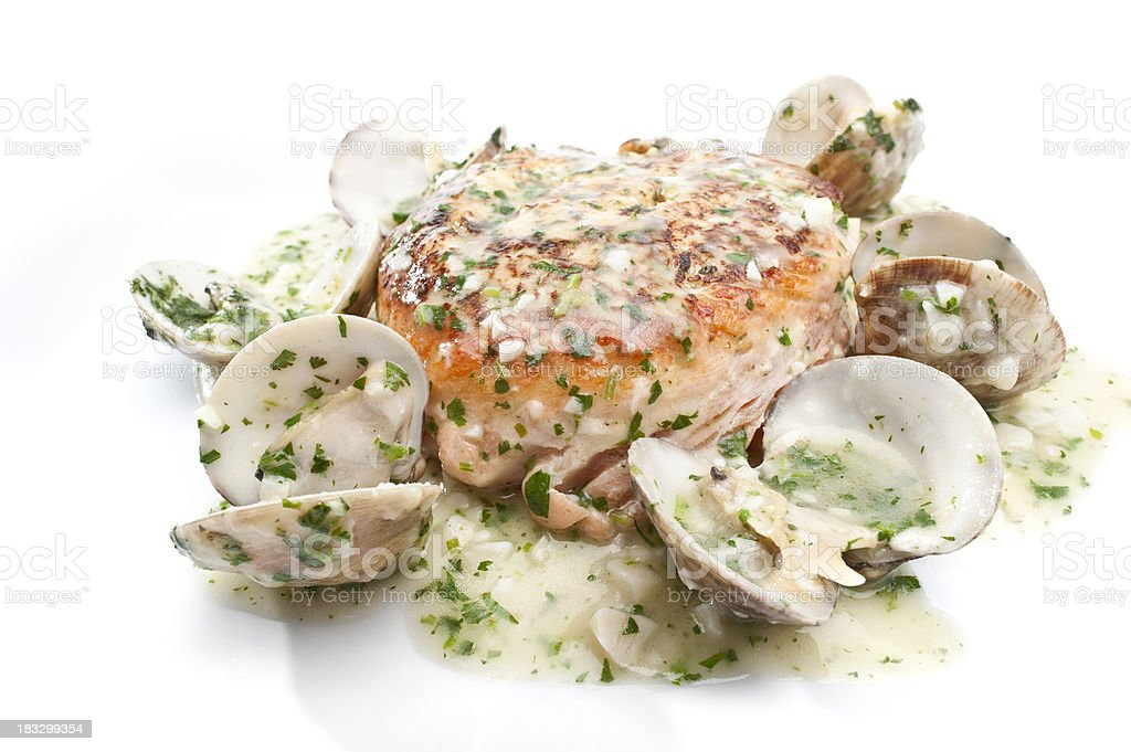 Baked crabmeat stuffed fillet of salmon with clams stock photo