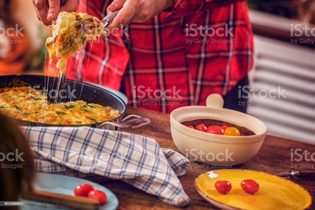 Baked Crepes Pancakes with Ham and Tomatoes stock photo