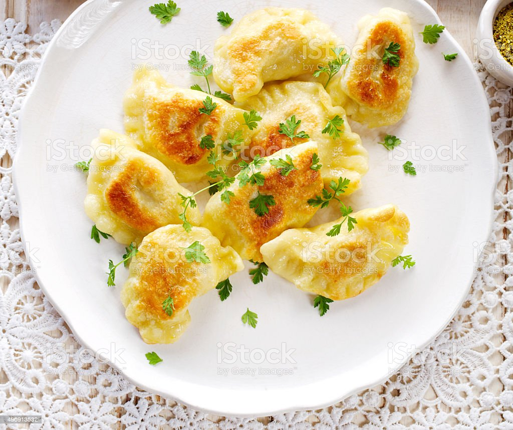 Baked dumplings filled cheese and potato stock photo