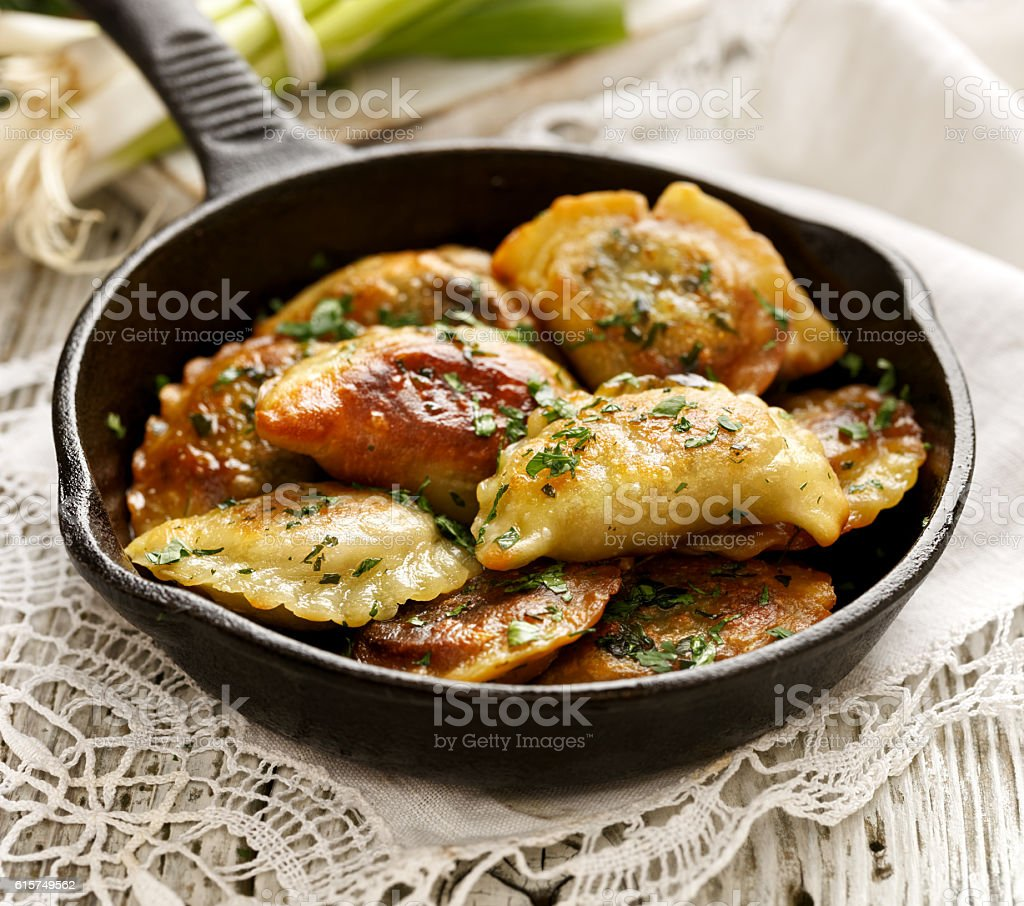 Baked dumplings on a cast-iron frying pan stock photo