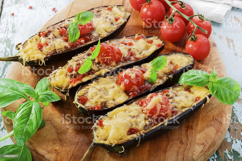 baked eggplant with cheese meat and tomatoes stock photo