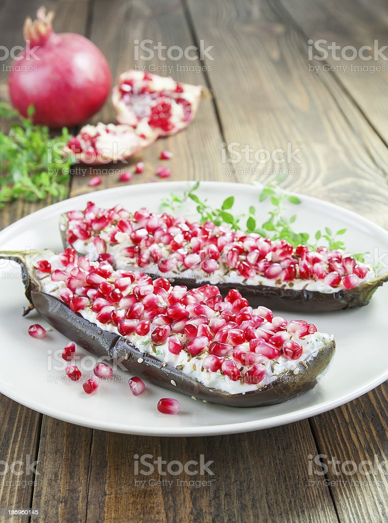 Baked eggplant with cheese, pomegranate and cumin royalty-free stock photo