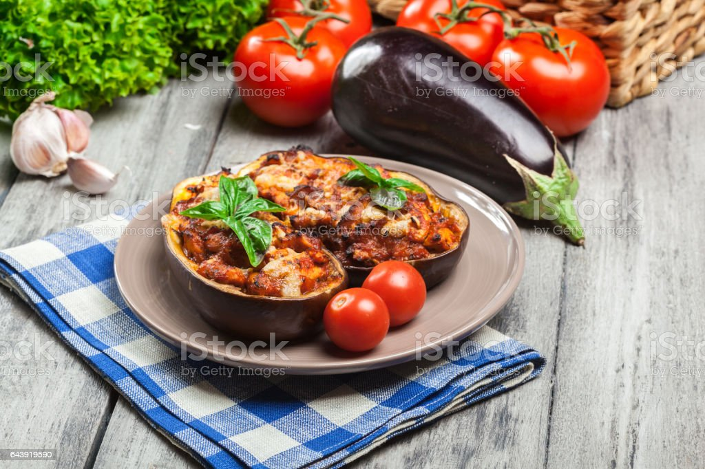 Baked eggplant with pieces of chicken stock photo