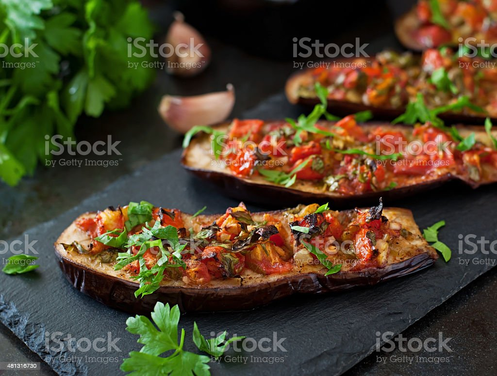 Baked eggplant with tomatoes, garlic and paprika stock photo