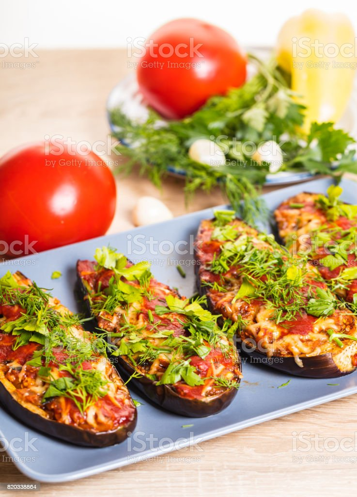 Baked eggplants with cheese stock photo