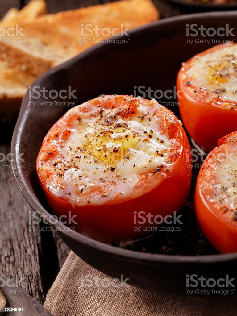 Baked Eggs in Tomatoes stock photo