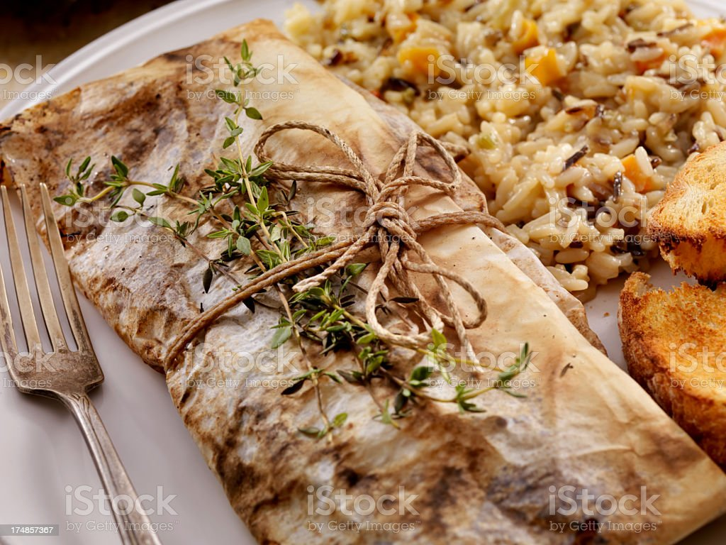 Baked Fish in Parchment Paper royalty-free stock photo