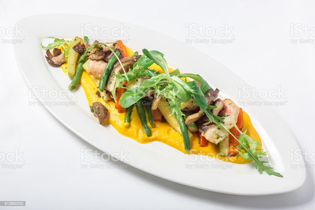 Baked fish King clip with vegetables and sauce. Close-up stock photo