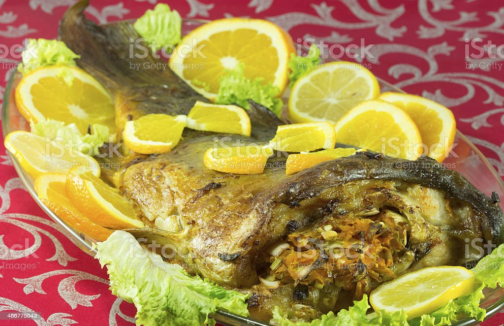 Baked fish stuffed with vegetables stock photo
