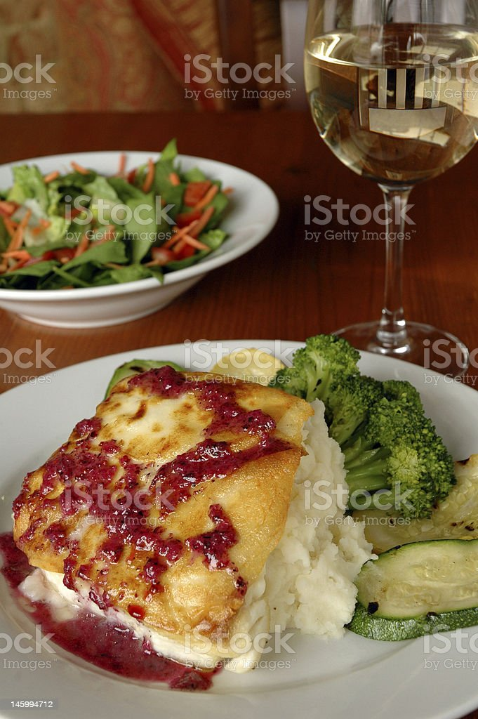 Baked fish with raspberry royalty-free stock photo