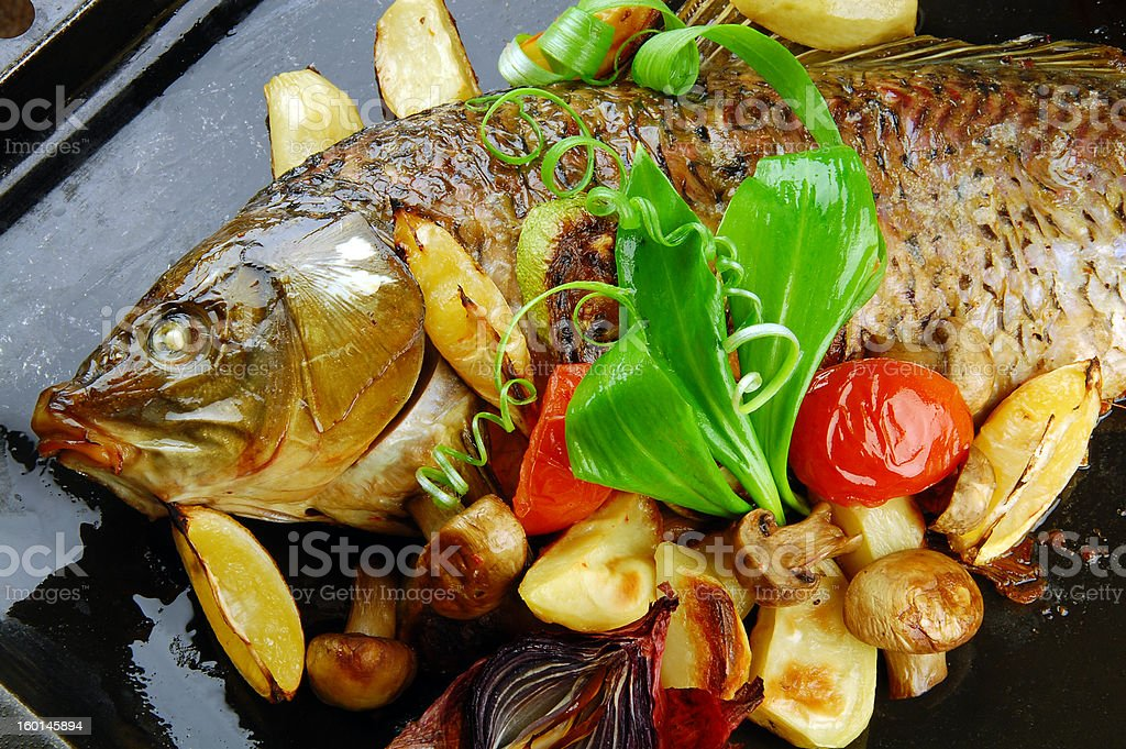 Baked fish with vegetables royalty-free stock photo