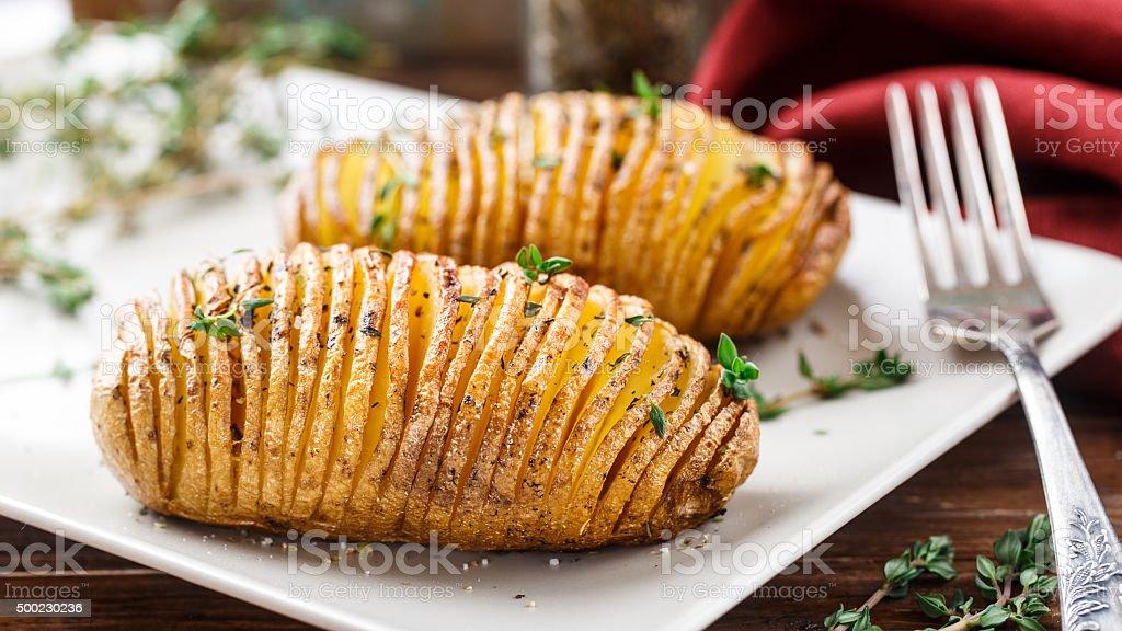 Baked hasselback potatoes stock photo