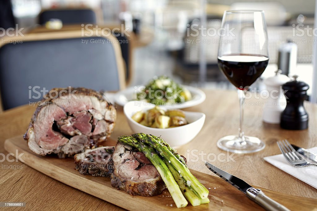 Baked lamb meat served with asparagus royalty-free stock photo