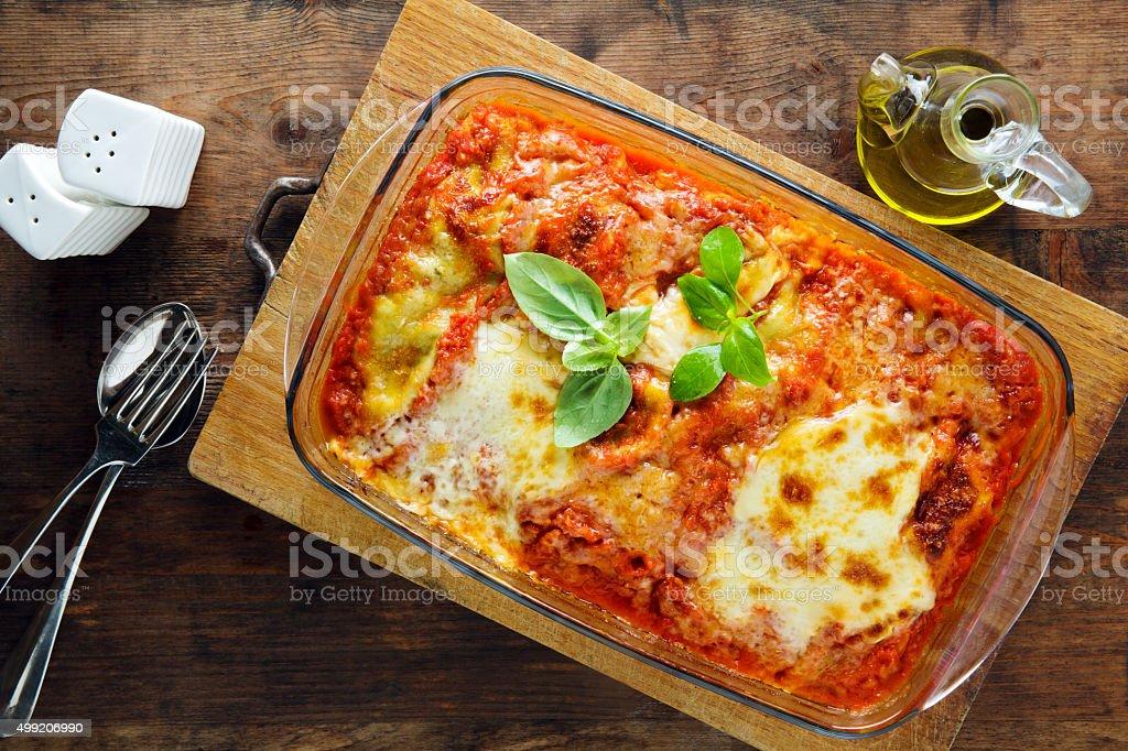 baked lasagna on a baking sheet stock photo