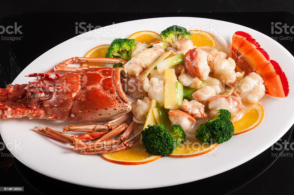 Baked lobster with ginger and scallion stock photo