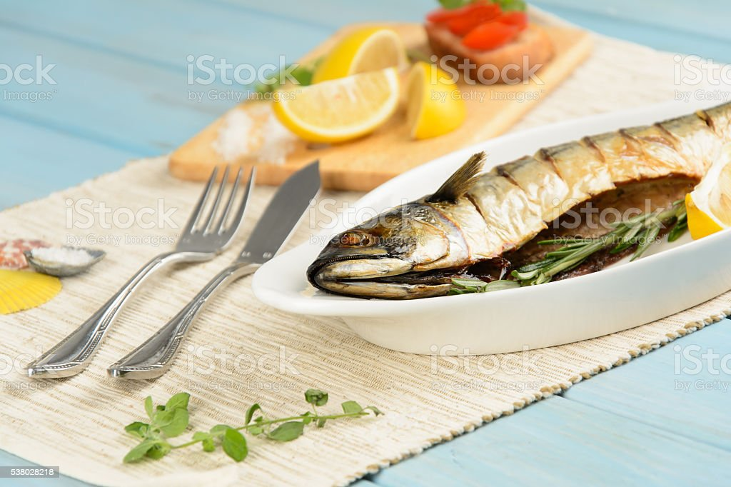 Baked mackerel with lemon stock photo