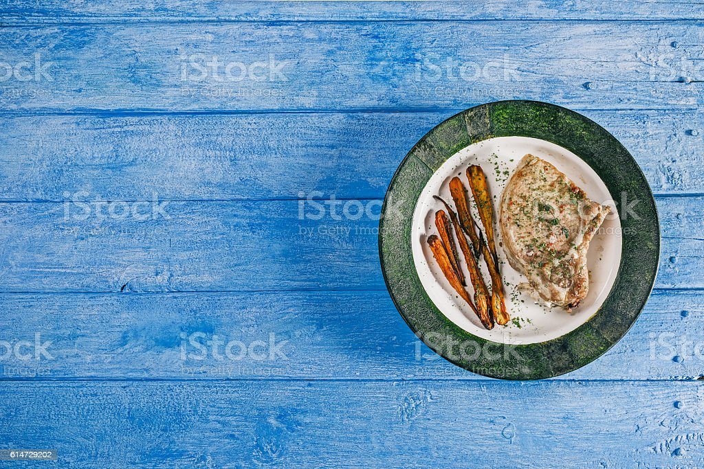Baked meat and carrot on the tray stock photo